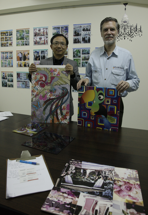 Dr. Alex Lu President with Nicholas showing samples of Magic ink